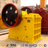 Jaw crusher in the size adjustment device (a)